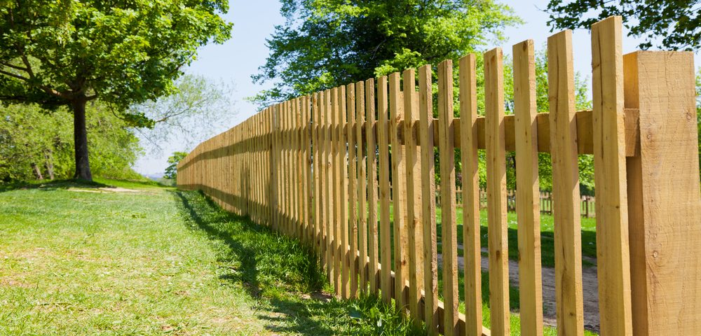 installing fence materials sloped surface